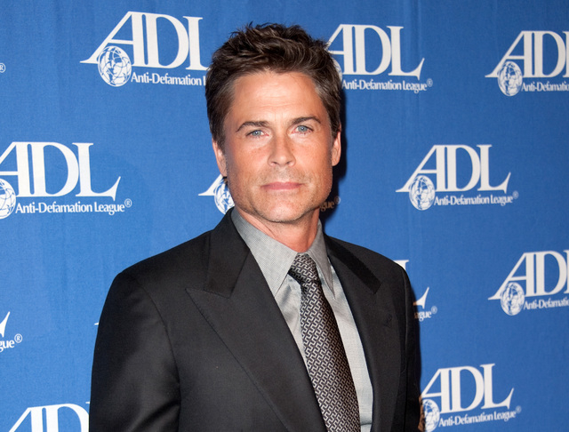 In this Oct. 16, 2012 file photo, actor Rob Lowe attends the Entertainment Industry Awards Dinner at the Beverly Hilton Hotel in Beverly Hills, Calif. Lowe stars in ads for DirecTV encouraging peo ...