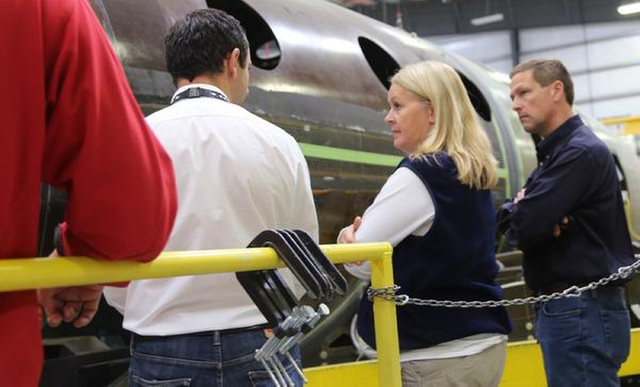This Nov. 2, 2014, photo provided by the National Transportation Safety Board shows Lorenda Ward, investigator in charge of the SpaceShipTwo accident, in the spaceship company's production facilit ...
