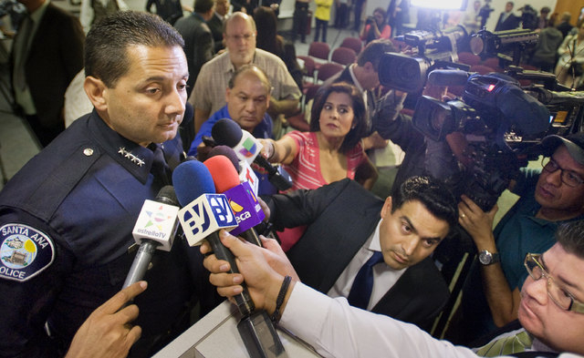 Santa Ana Police Chief Carlos Rojas talks with the media during a press conference Monday Nov. 3, 2014, in Santa Ana, California, announcing a suspect in the hit-and-run deaths of three girls on H ...