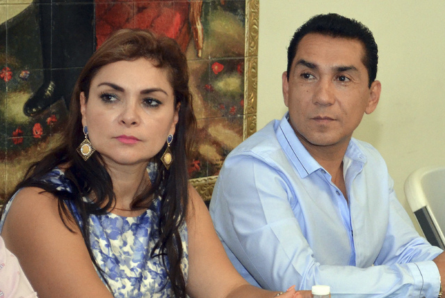 FILE - In this May 8, 2014 file photo, the mayor of the city of Iguala, Jose Luis Abarca, right, and his wife Maria de los Angeles Pineda Villa meet with state government officials in Chilpancingo ...