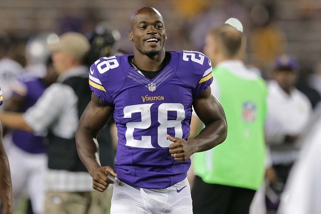In this Aug. 8, 2014, file photo, Minnesota Vikings running back Adrian Peterson (28) runs off the field after a exhibition NFL football game against the Oakland Raiders at TCF Bank Stadium in Min ...