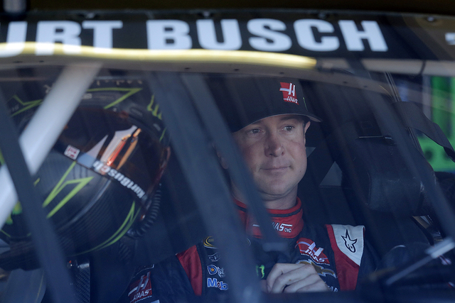 Driver Kurt Busch (41) gets ready before a practice session for Sunday's NASCAR Sprint Cup Series auto race on Friday, Nov. 7, 2014, in Avondale, Ariz.  (AP Photo/Rick Scuteri)