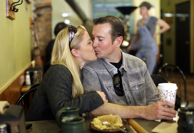 In this April 24, 2014, file photo, race car driver Kurt Busch, right, kisses his girlfriend Patricia Driscoll at a coffee shop in Ellicott City, Md. Police in Delaware say they are investigating  ...