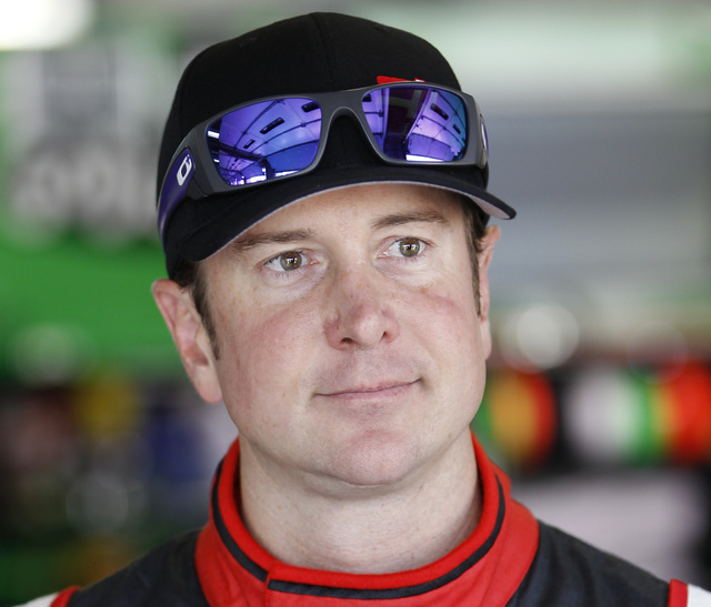 This is a May 22, 2014, file photo showing Kurt Busch waiting by his car before practice for the NASCAR Sprint Cup series Coca-Cola 600 auto race at Charlotte Motor Speedway in Concord, N.C. Polic ...