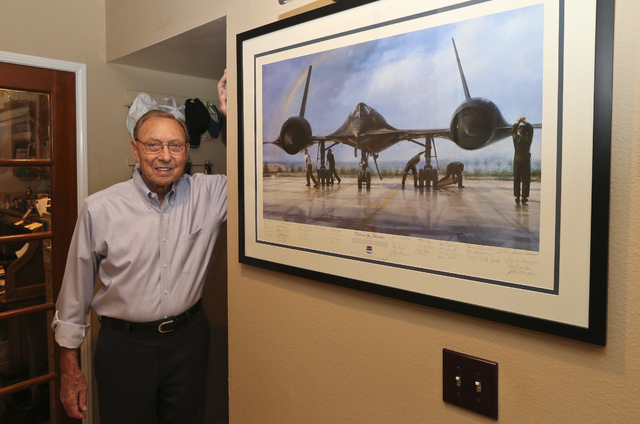 Bill Weaver, 86, poses next to artwork depicting the SR-71 Blackbird spy plane that he flew as a test pilot in 1966, on Thursday, Nov. 6, 2014, in Carlsbad, Calif.   Weaver was torn from his seat  ...
