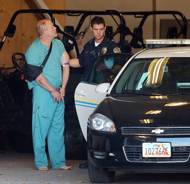 Sandy Police escort suspected kidnapper Troy Morley to a police car for transport to the Salt Lake County Jail, Friday, Nov. 7, 2014, in Sandy, Utah. Morley was confronted by a Utah dad after he a ...
