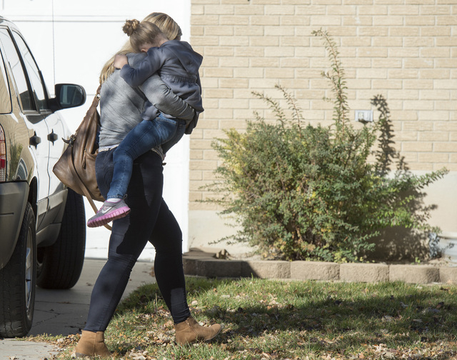 A Sandy family returns home with their daughter after the girl's father rescued her from a man who tried to kidnap her on Friday, Nov. 7, 2014, in Sandy, Utah. The Utah dad foiled an attempt to ki ...