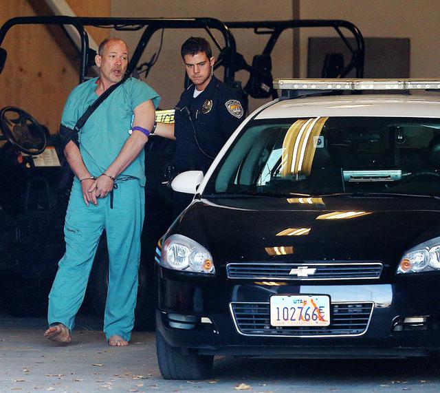 Sandy Police escort suspected kidnapper Troy Morley to a police car for transport to the Salt Lake County Jail, Friday, Nov. 7, 2014, in Sandy, Utah. (AP Photo/The Deseret News, Scott G. Winterton)