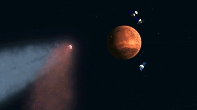 This handout artist's concept provided by NASA/JPL shows the Comet Siding Spring approaching Mars, shown with NASAs orbiters preparing to make science observations of this unique encounter. A pris ...