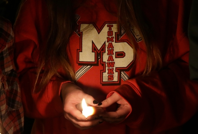 Madison Wahlgren, 15, a sophomore at Marysville-Pilchuck High School, holds a candle following a memorial vigil at the Grove Church in Marysville, Washington, Oct. 24, 2014. Student Jayson Fryberg ...