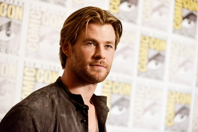 In this July 26, 2014 file photo, Chris Hemsworth attends the Marvel press line at Comic-Con International in San Diego. People magazine has named Chris Hemsworth the Sexiest Man Alive of 2014, ch ...