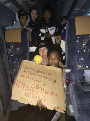This photo provided by Chelsea Andorka, the Niagara University womens basketball team spokeswoman, shows the team holding a sign while their bus was snowbound on the New York State Thruway in the  ...