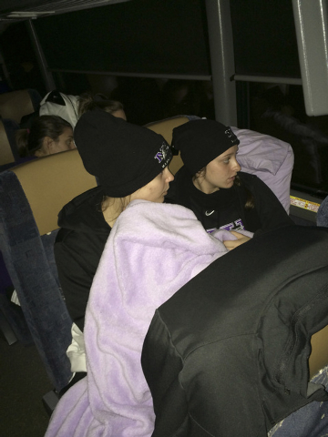 In this photo provided by Niagara's Tiffany Corselli, teammates Gabby Baldasare and Jamie Sherburne huddle under a blanket while stuck on a bus near Buffalo, N.Y., Tuesday, Nov. 18, 2014. The NCAA ...