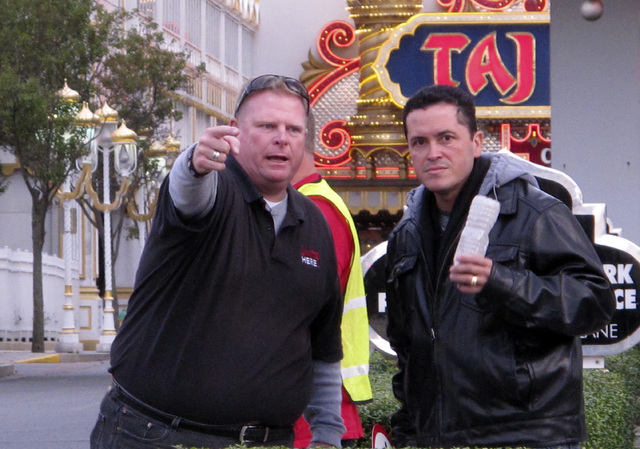 In this photo taken on Oct. 24, 2014, Robert McDevitt, left, president of Local 54 of the Unite-HERE casino workers union, gestures at a protest outside the Trump Taj Mahal Casino Resort in Atlant ...