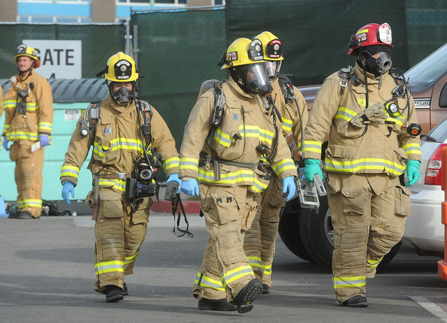 Hazardous materials firefighter crews responded to Ventura County Medical Center, Tuesday, Nov. 18, 2014, in Ventura, Calif., after emergency personnel who came into contact with the injured peopl ...