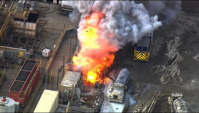 In this aerial still frame from video provided by Fox 11 LA, a waste treatment facity burns after an unstable chemical mixture exploded in Santa Paula, Calif., early Tuesday, Nov. 18, 2014, sendin ...