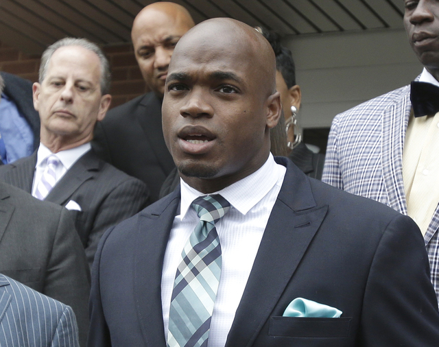 In this Nov. 4, 2014, file photo, Minnesota Vikings running back Adrian Peterson speaks to the media after pleading no contest to an assault charge in Conroe, Texas. The NFL suspended Adrian Peter ...