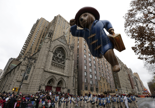 The Paddington Bear balloon cruises over Central Park West during the Macy's Thanksgiving Day Parade, Thursday, Nov. 27, 2014, in New York. (AP Photo/Julio Cortez)