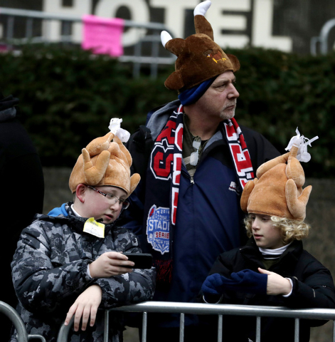 People wear turkey hats while they wait for the start of the Macy's Thanksgiving Day Parade, Thursday, Nov. 27, 2014, in New York. (AP Photo/Julio Cortez)