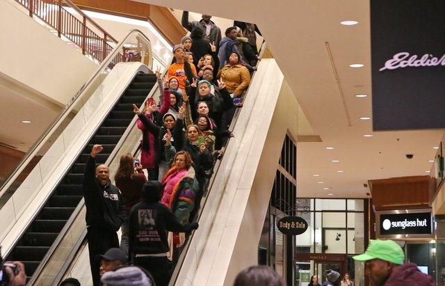 Protesters of the grand jury decision in the Michael Brown shooting chant slogans at the St. Louis Galleria mall on Wednesday evening, Nov. 26, 2014, in Richmond Heights, Mo. They stayed in the ma ...