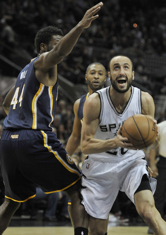 San Antonio Spurs guard Manu Ginobili, right, of Argentina, drives around Indiana Pacers forward Solomon Hill during the first half of an NBA basketball game, Wednesday, Nov. 26, 2014, in San Anto ...