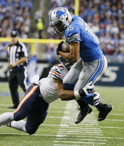 Detroit Lions wide receiver Golden Tate (15) is tackled by Chicago Bears inside linebacker Jon Bostic during the first half of an NFL football game in Detroit, Thursday, Nov. 27, 2014. (AP Photo/R ...