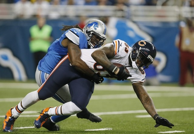 Chicago Bears tight end Martellus Bennett (83) is stopped by Detroit Lions linebacker Josh Bynes (57) during the second half of an NFL football game in Detroit, Thursday, Nov. 27, 2014. (AP Photo/ ...