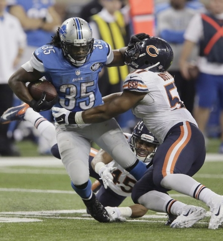 Detroit Lions running back Joique Bell (35) stiff arms Chicago Bears inside linebacker Jon Bostic (57) during the second half of an NFL football game in Detroit, Thursday, Nov. 27, 2014. (AP Photo ...