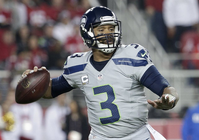 Seattle Seahawks quarterback Russell Wilson (3) passes against the San Francisco 49ers during the second quarter of an NFL football game in Santa Clara, Calif., Thursday, Nov. 27, 2014. (AP Photo/ ...
