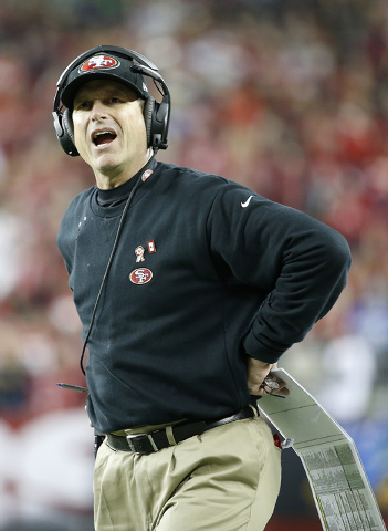 San Francisco 49ers head coach Jim Harbaugh stands on the sideline during the first half of an NFL football game against the Seattle Seahawks in Santa Clara, Calif., Thursday, Nov. 27, 2014. (AP P ...