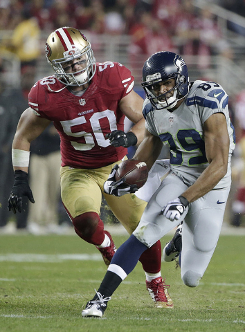 Seattle Seahawks wide receiver Doug Baldwin (89) runs from San Francisco 49ers inside linebacker Chris Borland (50) during the first quarter of an NFL football game in Santa Clara, Calif., Thursda ...