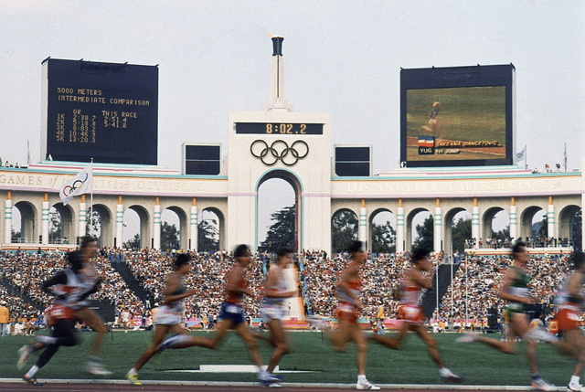 A field of entrants compete in the men's 5,000-meter event at the Summer Olympic Games in Los Angeles, Aug. 11, 1984. Glamour, celebrities, perfect weather. A revitalized and growing downtown. Ico ...