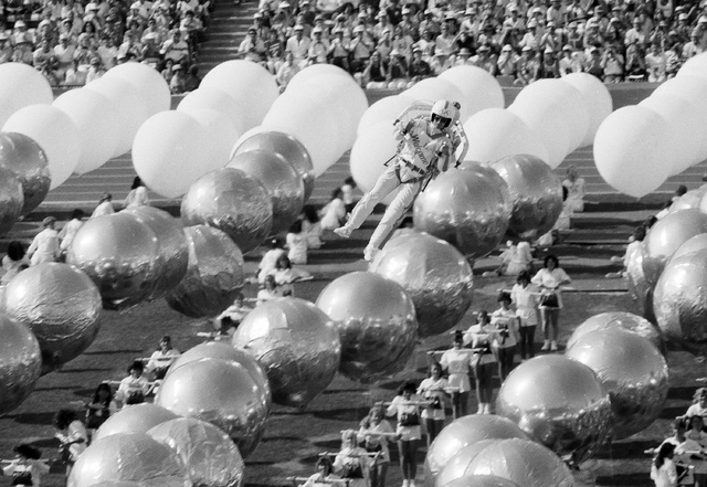 "Bill Suiter, the official ""Rocket Man"" of the opening ceremonies of the 1984 Summer Olympics, zooms in through the Olympic Drill Team and 5-foot helium balloons as festivities got underway at the  ..."