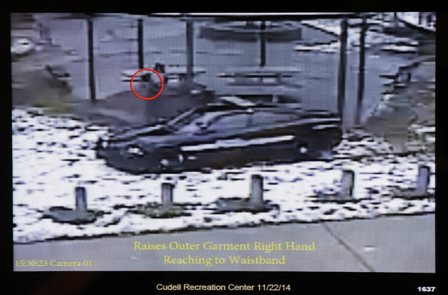 This still image taken from a surveillance video played at a news conference held by Cleveland police, Wednesday, Nov. 26, 2014, shows Cleveland police officers arriving at Cudell Park on a report ...