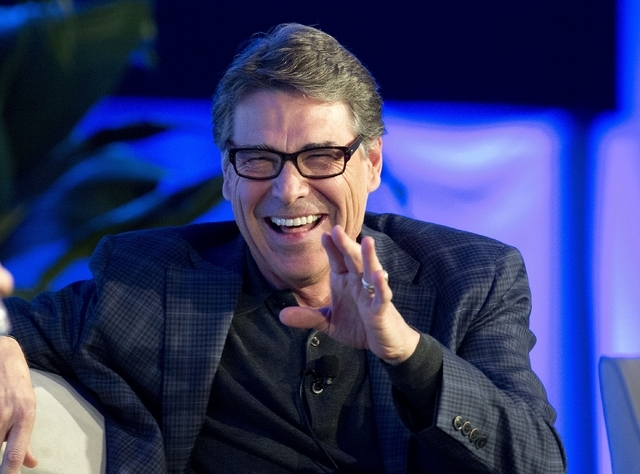 FILE - This Nov. 19, 2014, file photo shows Texas Gov. Rick Perry at the Republican Governors Association annual conference in Boca Raton, Fla. The conference felt like a test run for what is incr ...