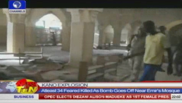In this frame grab from video provided by NTA/Channels TV, people inspect the inside of a mosque after multiple explosions tore through the building, killing at least 35 people, according to polic ...