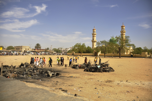 People inspect the site of a  bomb explosion at the central mosque, in Kano, Nigeria, Saturday Nov. 29, 2014. More than 102 people were killed in the bomb explosions at the central mosque in Kano, ...