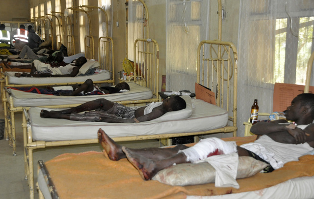 Victims of  the bomb explosion at the central mosque receive treatment at the Murtala Muhammed specialist hospital, in Kano, Nigeria, Saturday Nov. 29, 2014.  Nigeria in Kano Nigeria. More than 10 ...