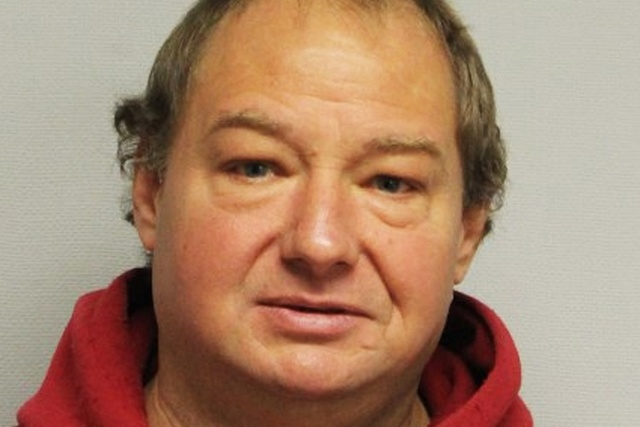 Roger Pelletier o fPortsmouth, N.H., broke into his neighbor's apartment to silence a barking dog and ended up getting bitten and arrested. (AP Photo/Portsmouth Police Department)