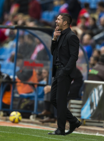 Atletico's coach Diego Simeone gestures during a Spanish La Liga soccer match between Atletico and Deportivo Coruna at the Vicente Calderon stadium in Madrid, Spain, Sunday, Nov. 30, 2014. (AP Pho ...