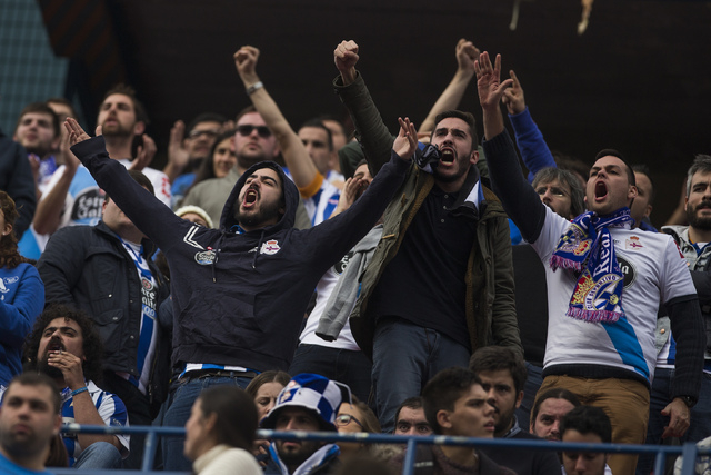 Coruna's fans react during a Spanish La Liga soccer match between Atletico and Deportivo Coruna at the Vicente Calderon stadium in Madrid, Spain, Sunday, Nov. 30, 2014.  (AP Photo/Andres Kudacki)