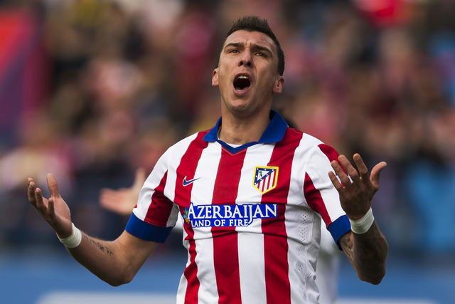 Atletico's Mario Mandzukic reacts during a Spanish La Liga soccer match between Atletico and Deportivo Coruna at the Vicente Calderon stadium in Madrid, Spain, Sunday, Nov. 30, 2014. (AP Photo/And ...