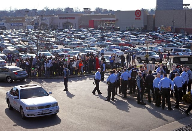 Protesters and police square off on the parking lot The Promenade at Brentwood during a demonstration on Saturday, Nov. 29, 2014, in Brentwood, Mo. (AP Photo/St. Louis Post-Dispatch, David Carson)