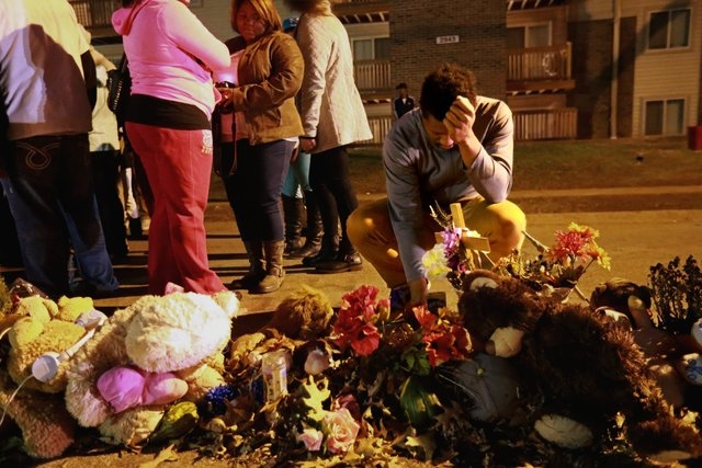 Curtis Minter, right of Akron, Ohio, prays at the memorial to Michael Brown in the Canfield Apartment complex on Saturday, Nov. 29, 2014. (AP Photo/St. Louis Post-Dispatch, Christian Gooden)