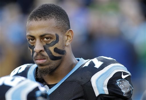 In this Dec. 15, 2013, file photo, Carolina Panthers' Greg Hardy watches before an NFL football game against the New York Jets in Charlotte, N.C. The Panthers announced Wednesday, Sept. 17, 2014,  ...