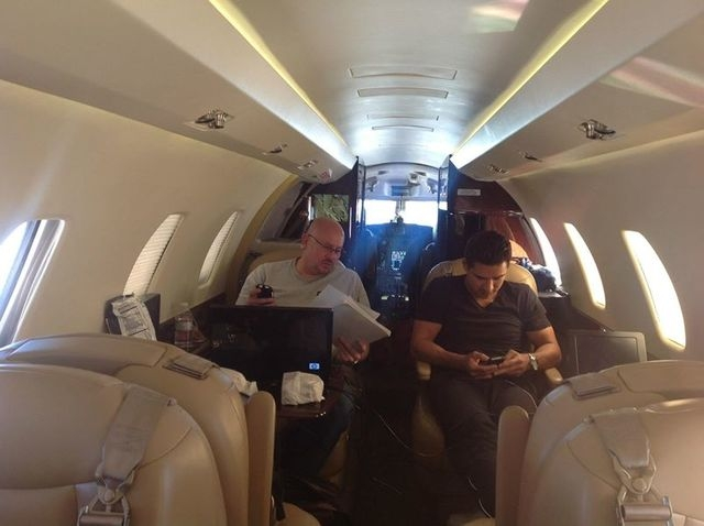 Celebrity agent Mike Esterman, left, on a private jet with Mario Lopez. (Courtesy/Mike Esterman)