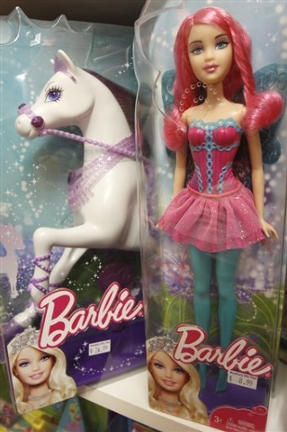 FILE - In this July 11, 2011, file photo, Barbie dolls appear on the shelf at Woodbury Mountain Toys in Montpelier, Vt. Elsa, Anna and the rest of the Frozen characters are the top toy for girls t ...