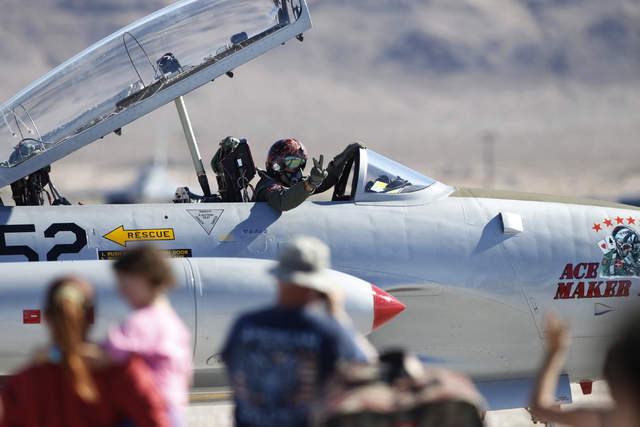 An F-86F Sabre aircraft pilot waves at spectators after performing during the Aviation Nation air show at Nellis Air Force Base in Las Vegas Saturday, Nov. 8, 2014. (Erik Verduzco/Las Vegas Review ...