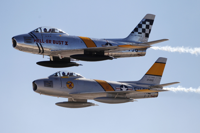 A pair of F-86F Sabre aircrafts perform during the Aviation Nation air show at Nellis Air Force Base in Las Vegas Saturday, Nov. 8, 2014. (Erik Verduzco/Las Vegas Review-Journal)