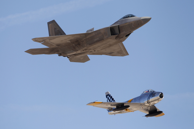An F-22 Raptor aircraft, left, performs with a F-86F Sabre aircraft during the Aviation Nation air show at Nellis Air Force Base in Las Vegas Saturday, Nov. 8, 2014. (Erik Verduzco/Las Vegas Revie ...